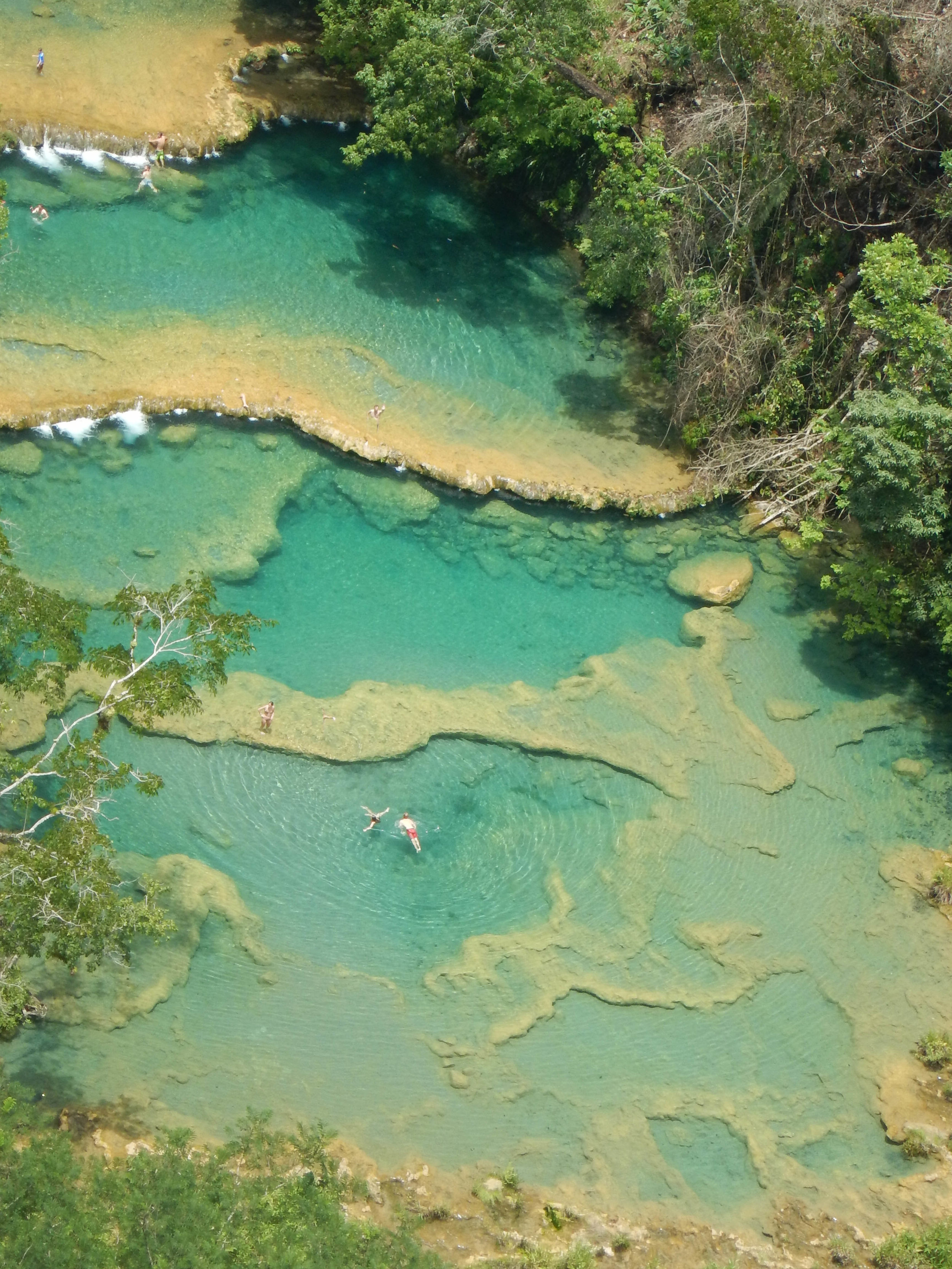 semuc champey with swimmers.jpg