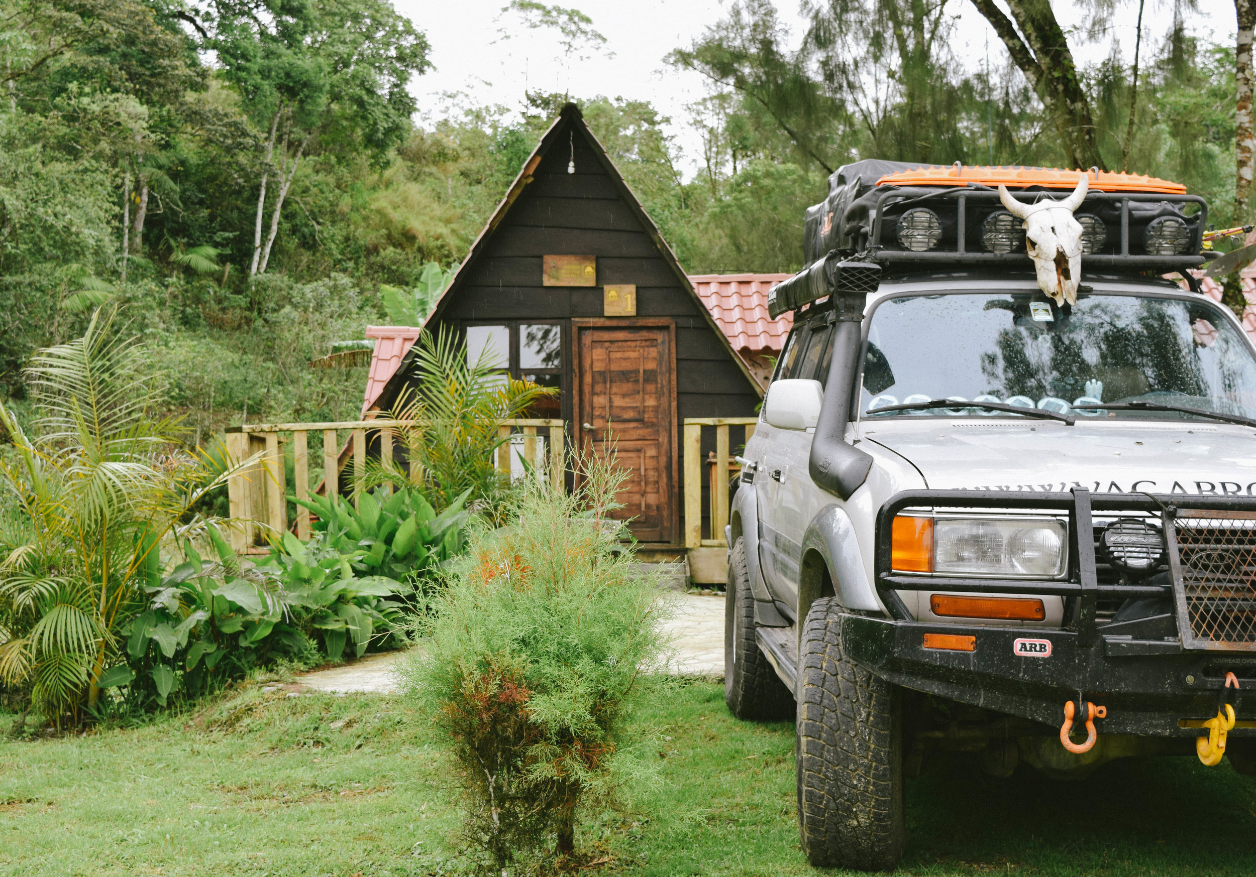 car in front of cabin at lago de montebello.jpg