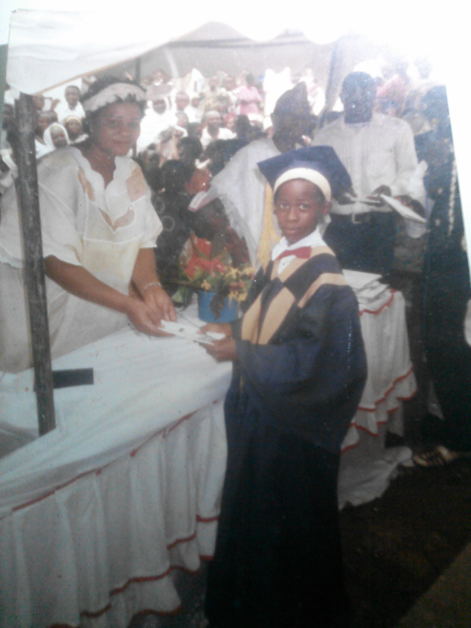 Obioma, age 11 or 12,receiving the award for best literature student at his primary school in 1998.