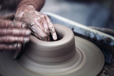 elderly hands spinning potter