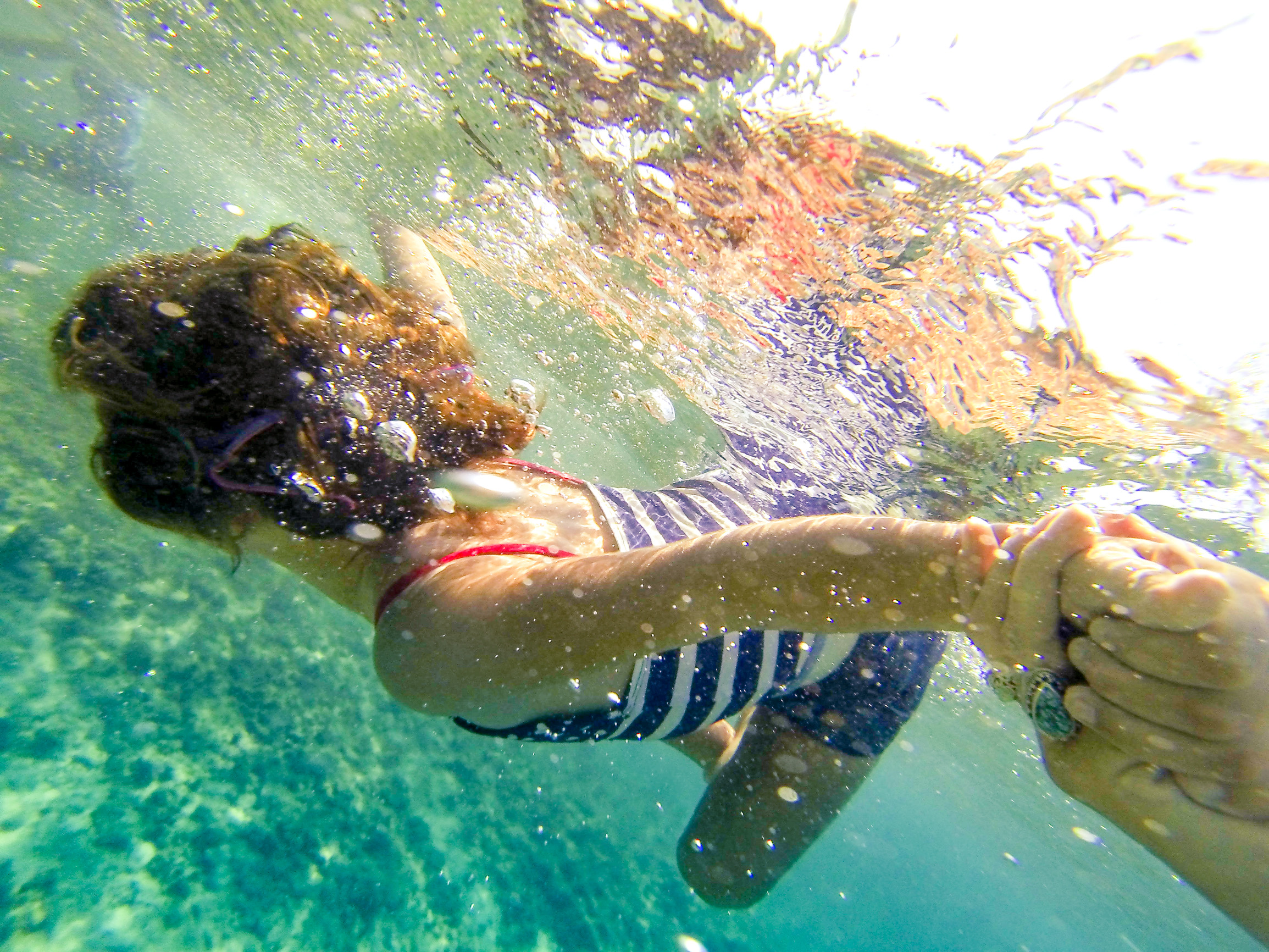 """This is 4-year-old Isa. Born a fish, she loves to be immersed in the ocean. This is what a """"Blue Minded"""" future looks like."""