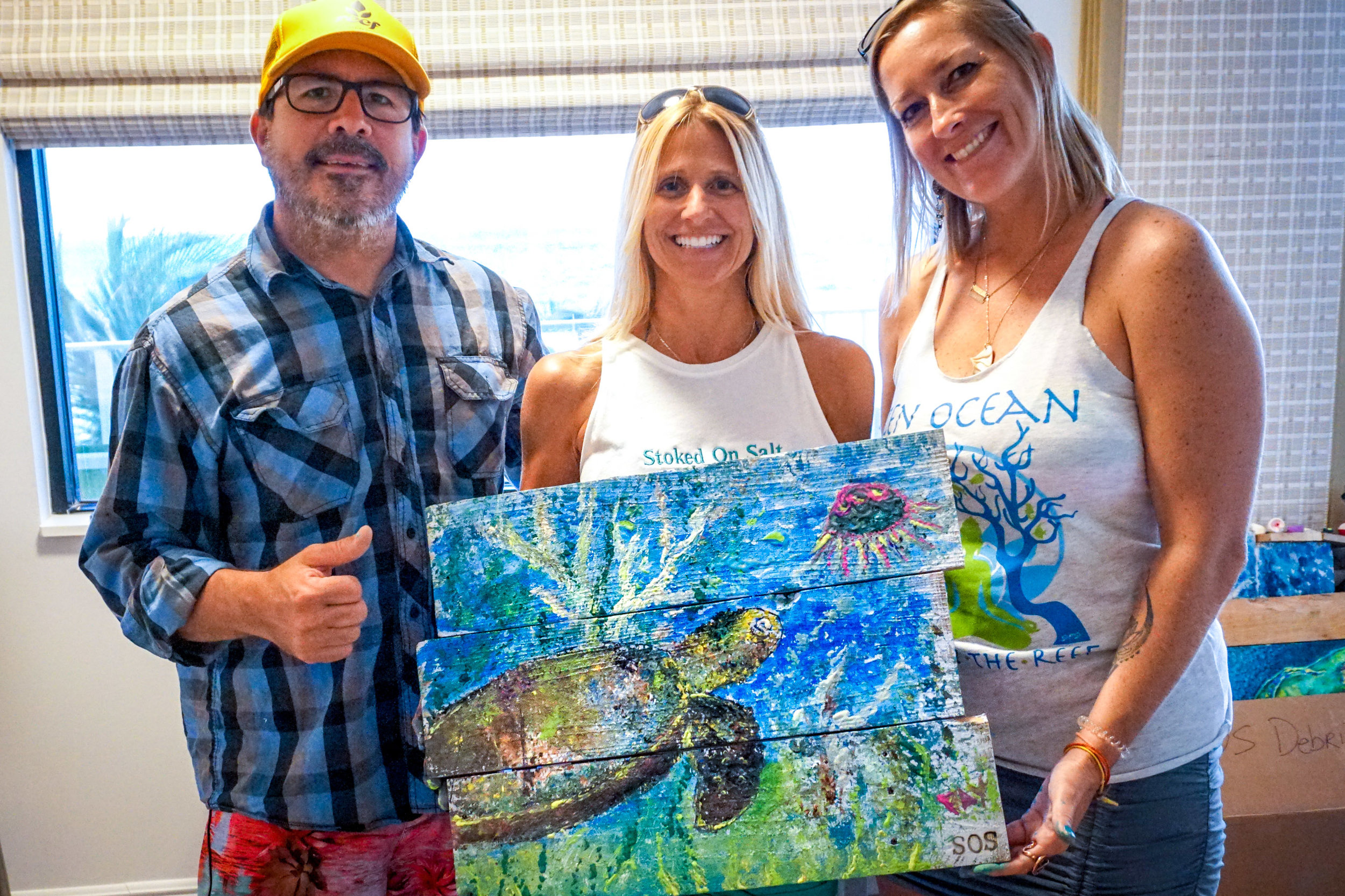 """Pay, Lisa Miceli of SOS, and Paola with our """"trashy art"""" made entirely from marine litter."""
