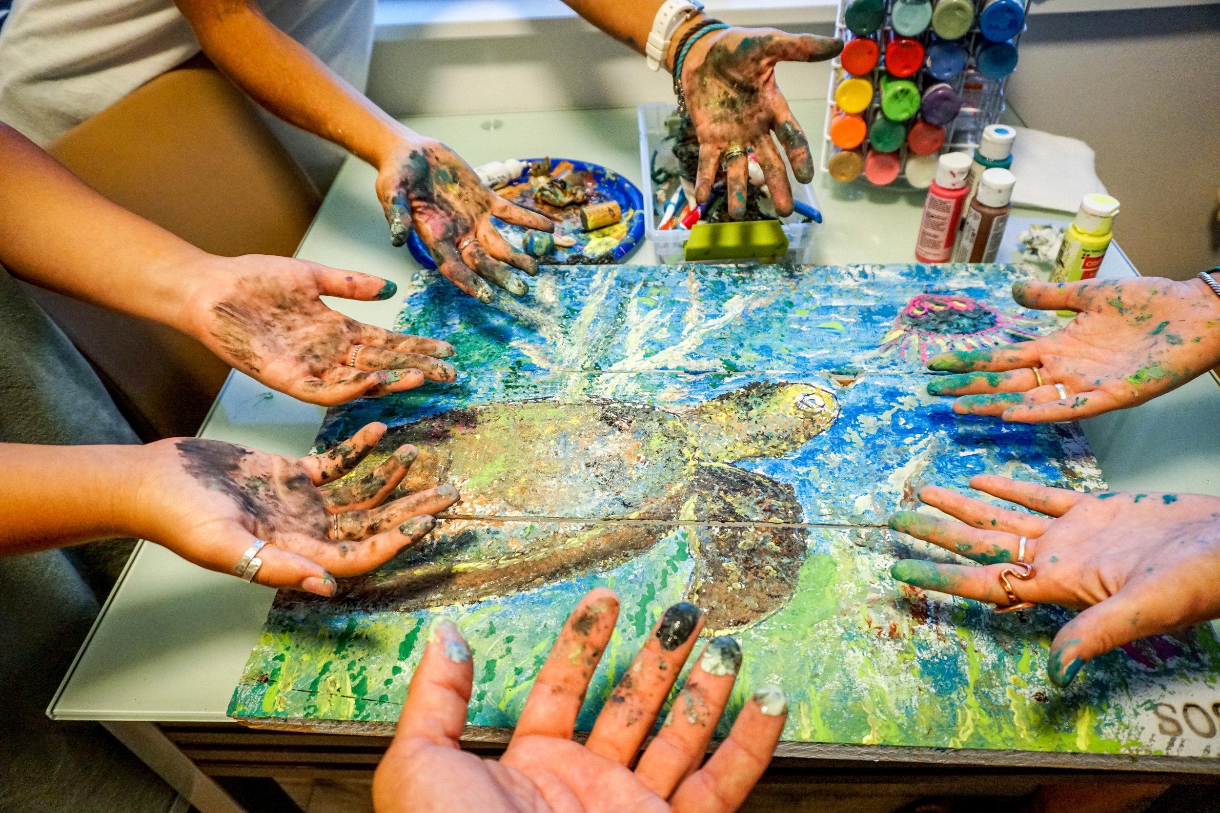 olapi-creative-blue-business-spotlight-sos-lisa-miceli-hands