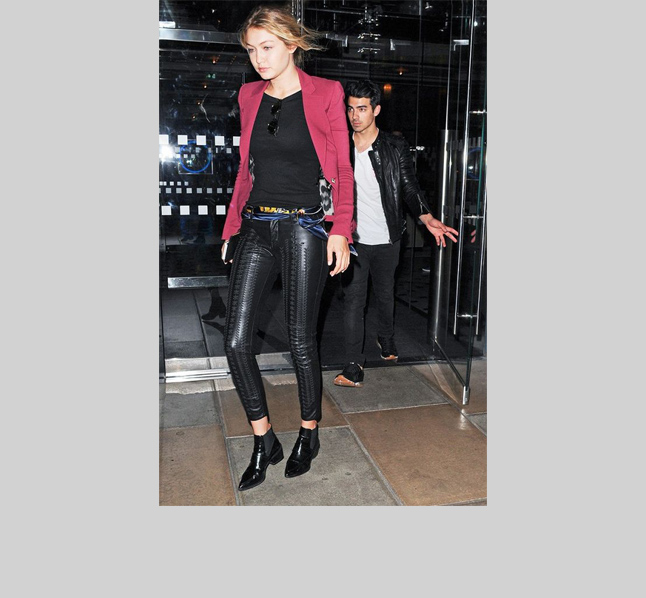 Gigi Hadid  The model and Instagram sensation finds insta-chic, elevating basics with a pink jacket for date night. The scarf belt is an inspired touch too. Hello--date night!