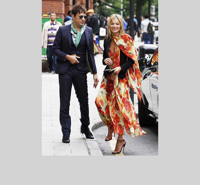 The queen of contrasts, Kate Moss counters the overt romance of this floral flowy gown with a fitted black tuxedo jacket.