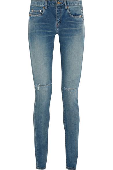 SAINT LAURENT Distressed mid-rise skinny jeans $750