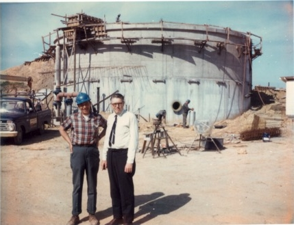 Warren Nute in front of the Mt View Sanitary District 'new' primary digester tank under construction in 1966.