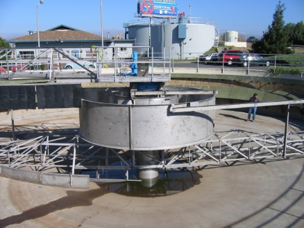 The same tank in the picture on the left is in the background, Nute Engineering will manage its rehabilitation in 2016, 50 years later. In 2011 Nute was the designer and CM for the New clarifier mechanism shown in the foreground.