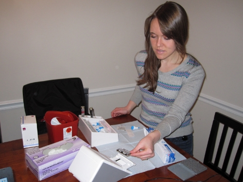 Amy prepping for a health screening.