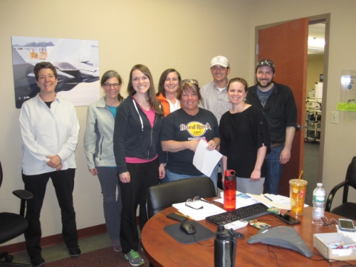 Amy with Whitcraft wellness committee members after a planning meeting.