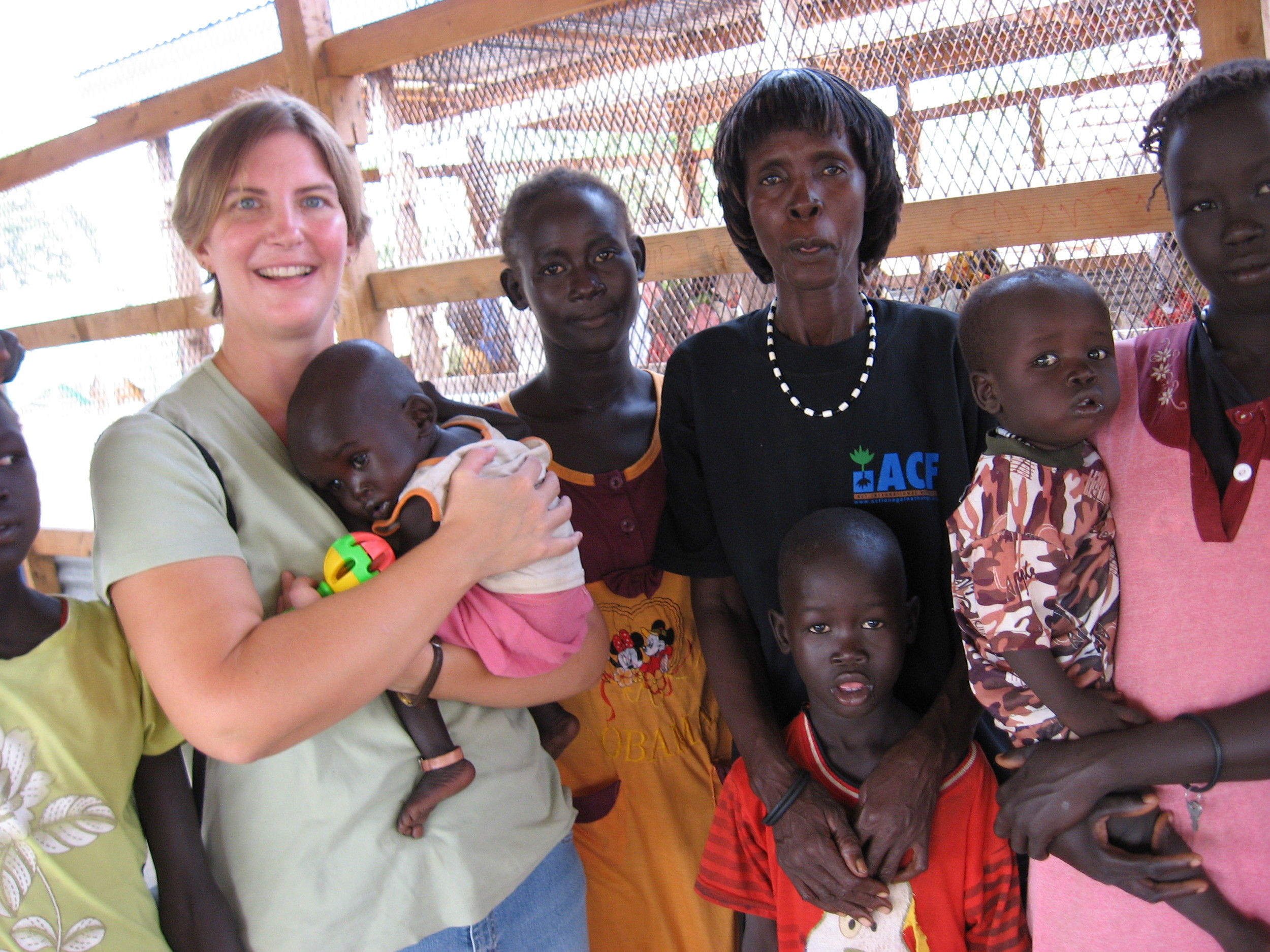 Sonya with several women and babies during a nutrition program in South Sudan.