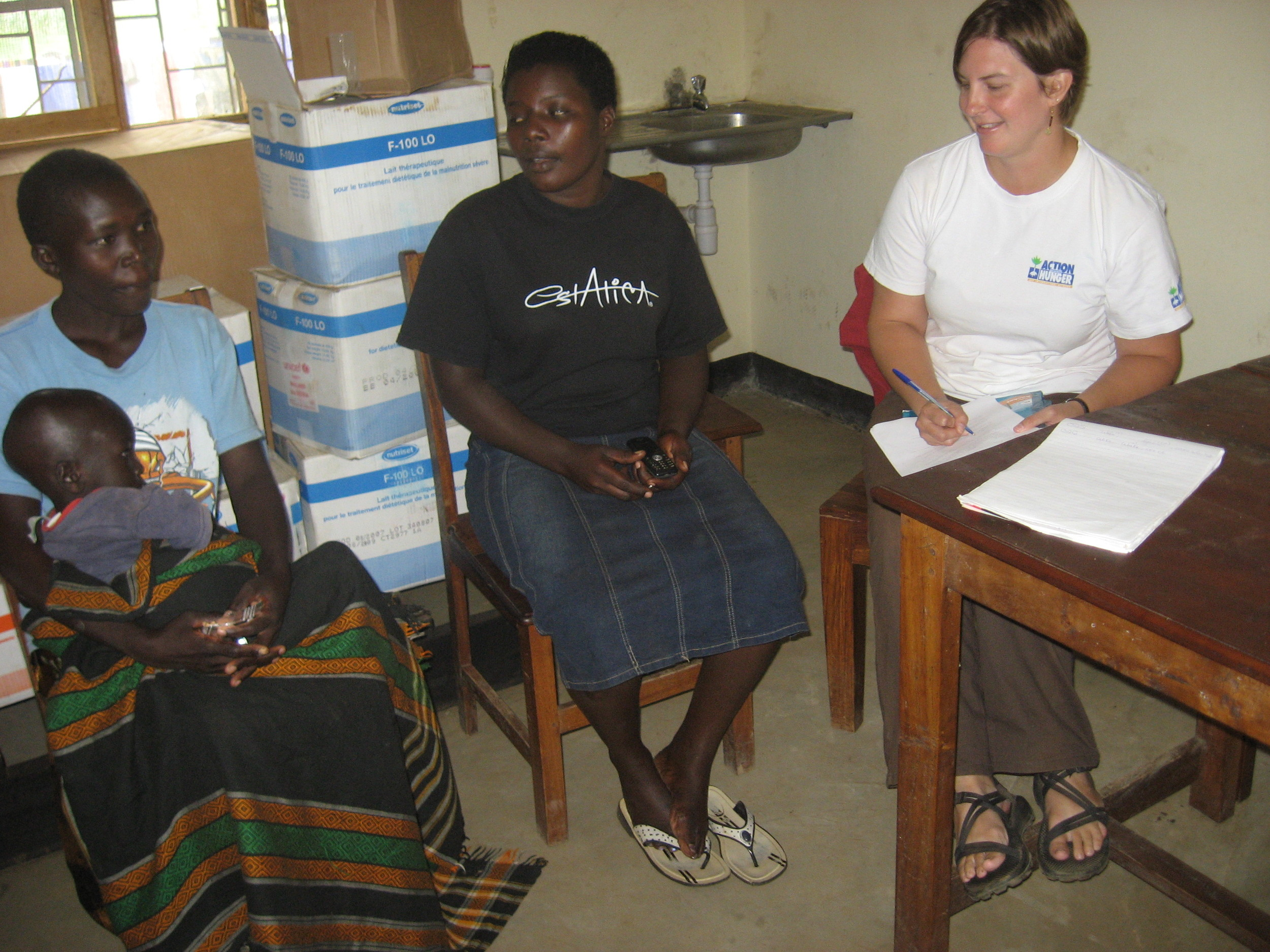 Conducting a one-on-one interview with the mother of a malnourished child at a Therapeutic Feeding Center in Lira, Uganda.