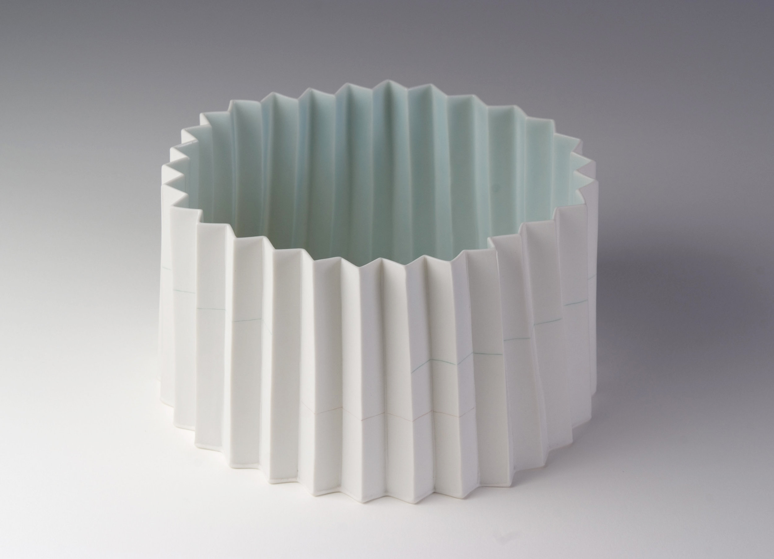Kenji Uranishi,  Pleated bowl  2009, porcelain with inlaid slip and celadon glaze, 11.8 x 20.0cm, Les Renfrew Bequest 2009, Newcastle Art Gallery collection