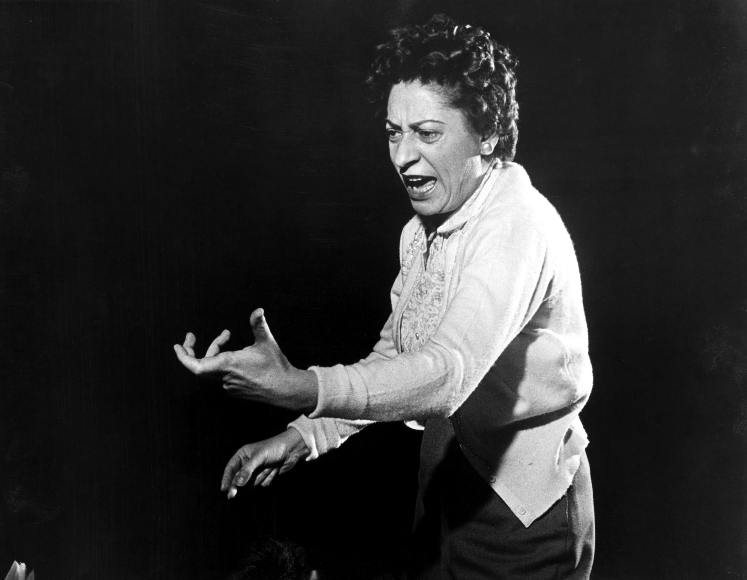 Ethel Stark conducting an orchestra rehearsal