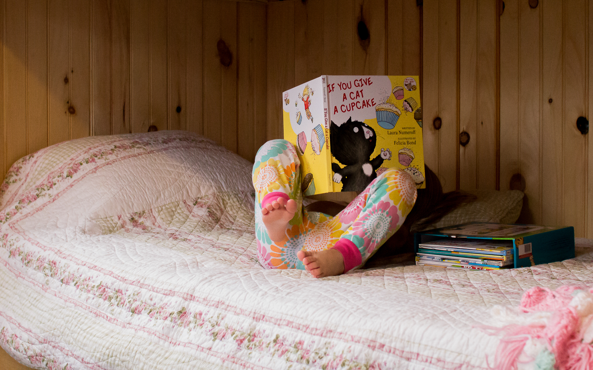 little girl reading if you give a mouse a cookie book