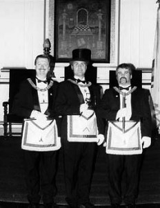 Wor. Rev. Henry I. Peirce as Master in 1999; to his right is Wor. Andrew R. Grove – Senior Warden, and right Bro. Adam Souza