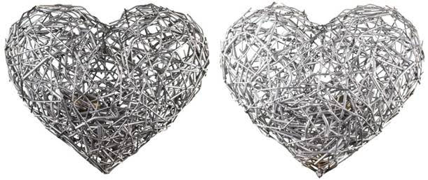 NESTED (2013) stainless steel heart with bronze egg inside