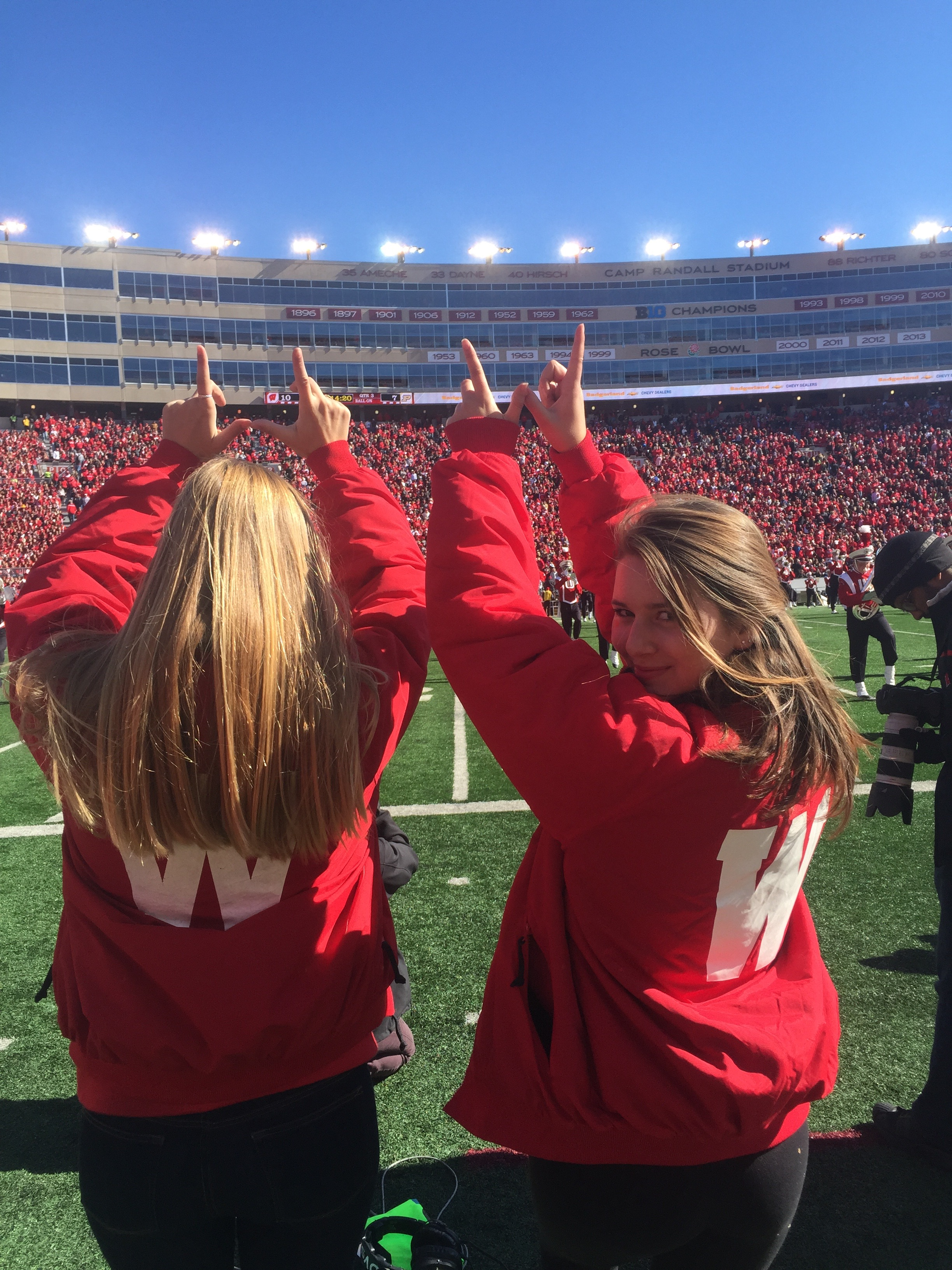 Natalie reps Homecoming in her 'dubs'on the Camp Randall field during halftime.