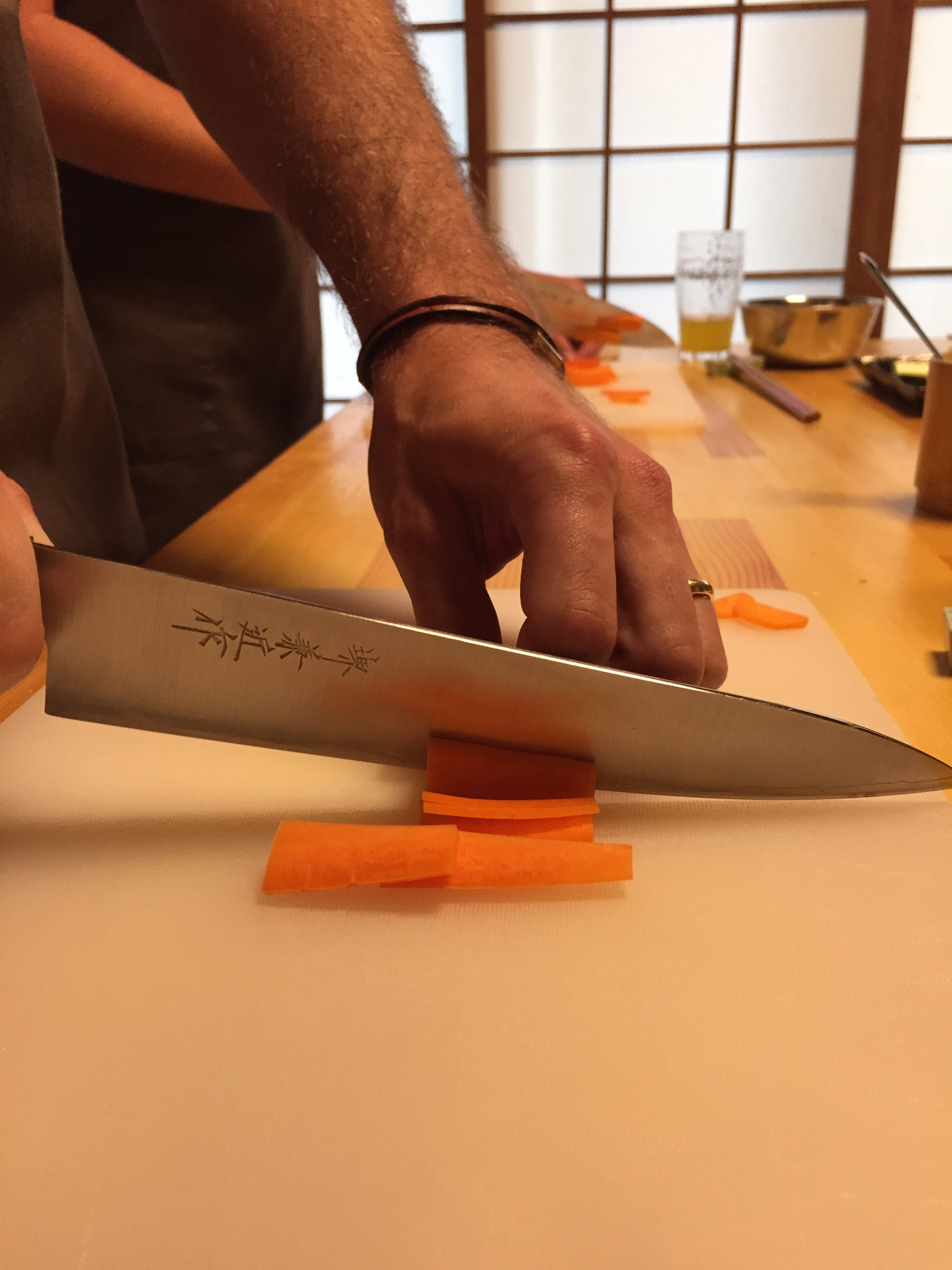 Cole chops carrots at our Osaka Eats cooking class