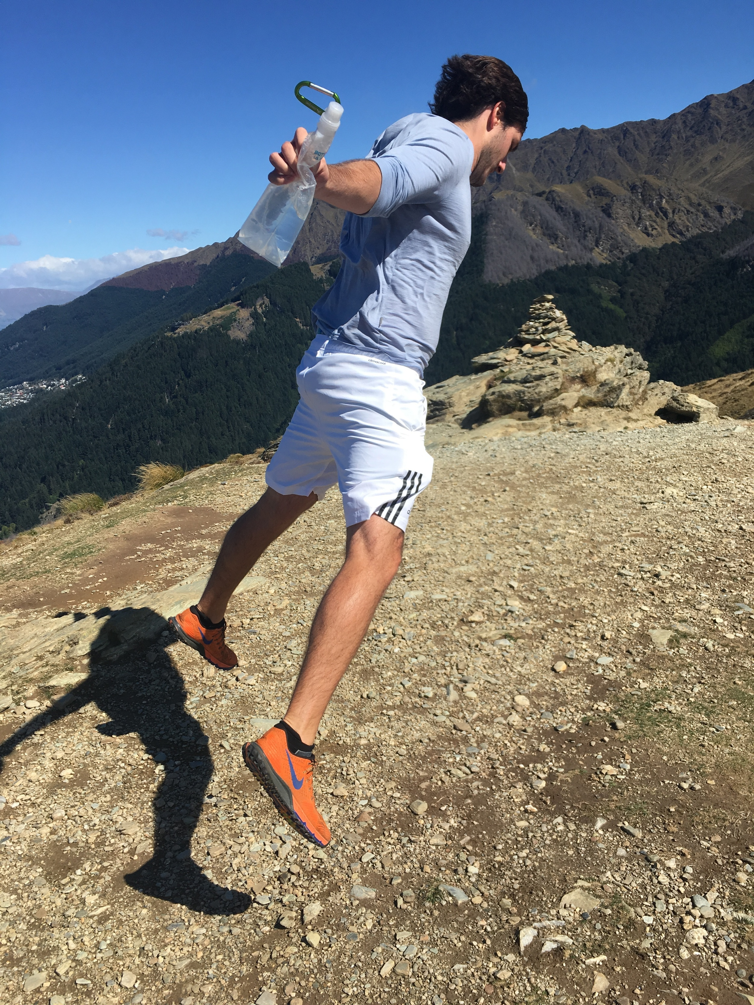 Cole trying to fly in the insane wind at the top of Queenstown Hill Hike