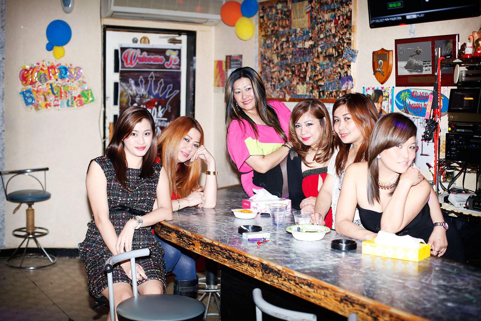 Filipino women in sailor town's bar Sasebo, Japan 2015