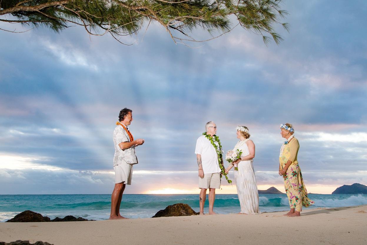 sunrise beach wedding ceremony photographer