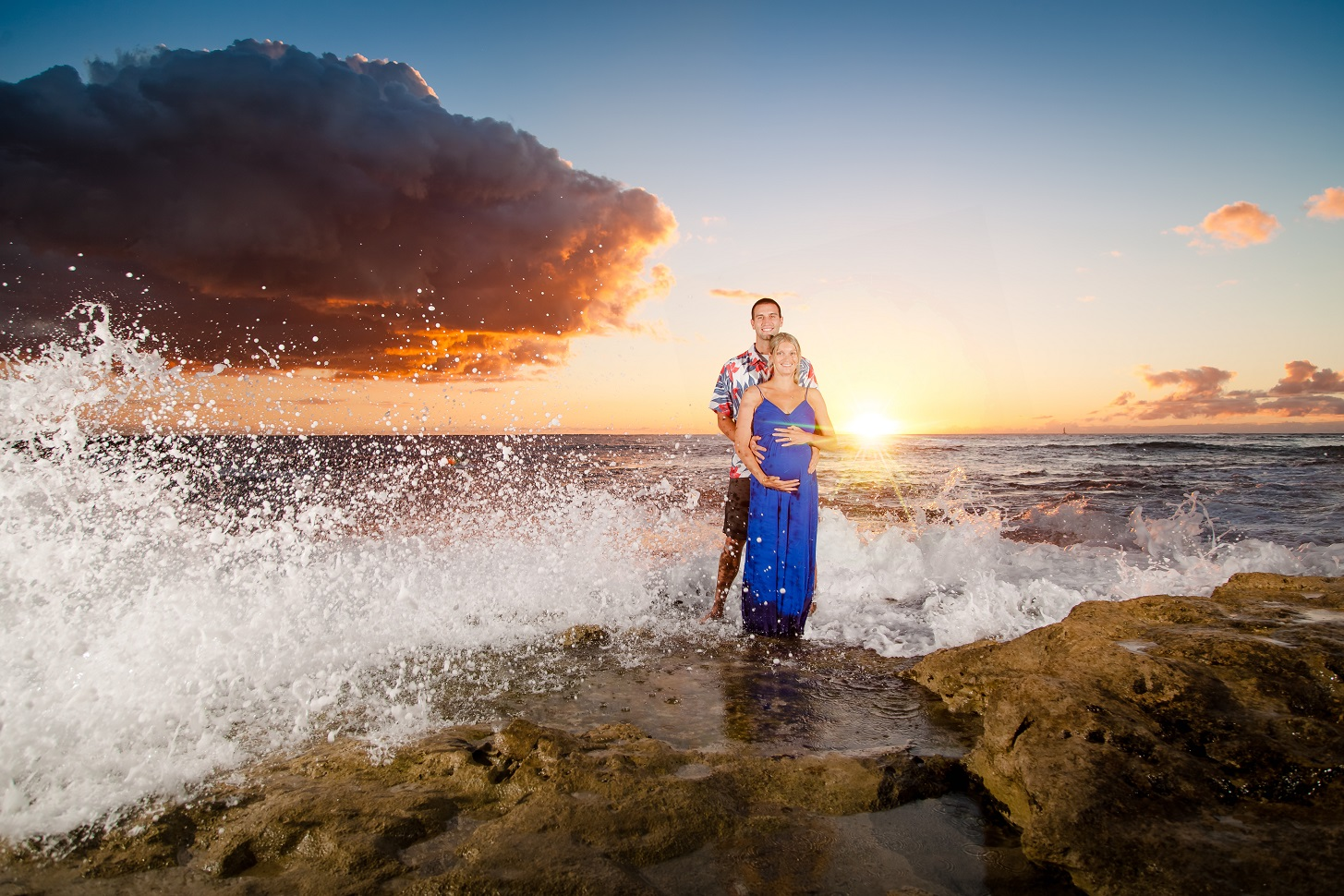 crashing wave baby expecting maternity couple hawaii portrait