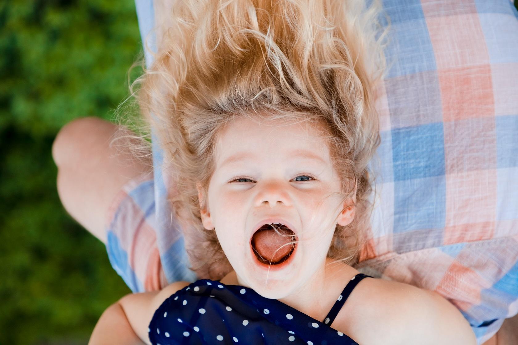 kid upside down laughing happy portrait