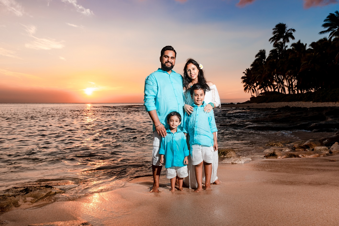 family portrait on hawaii beach sunset palm trees