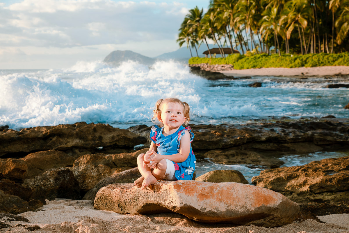 young girl sitting on rock family beach portrait aulani resort ko olina oahu