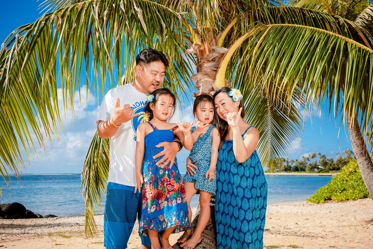 family waikiki beach portrait palm trees