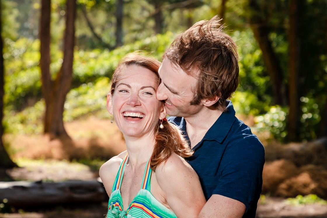 romantic couple laughing in hawaii sunshine portrait