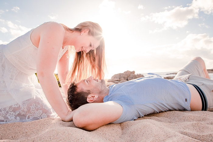 couples honeymoon portrait beach sunset oahu hawaii engagement