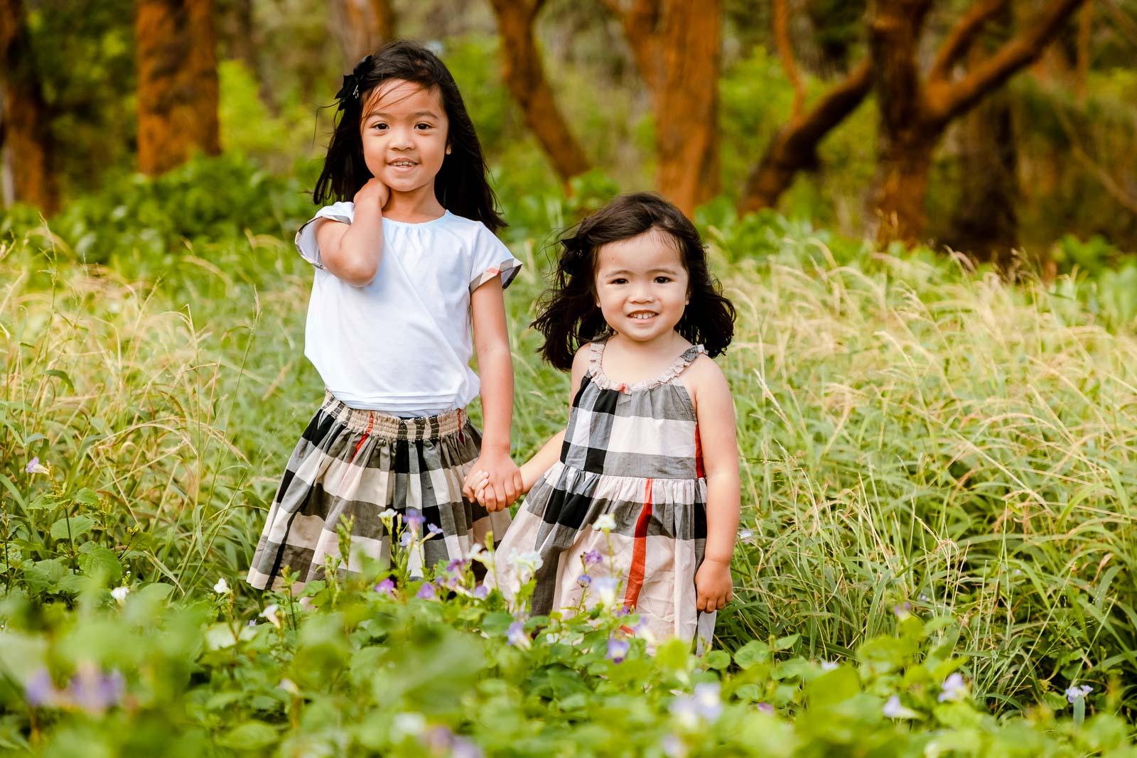 sisters portrait forest flowers grass oahu hawaii