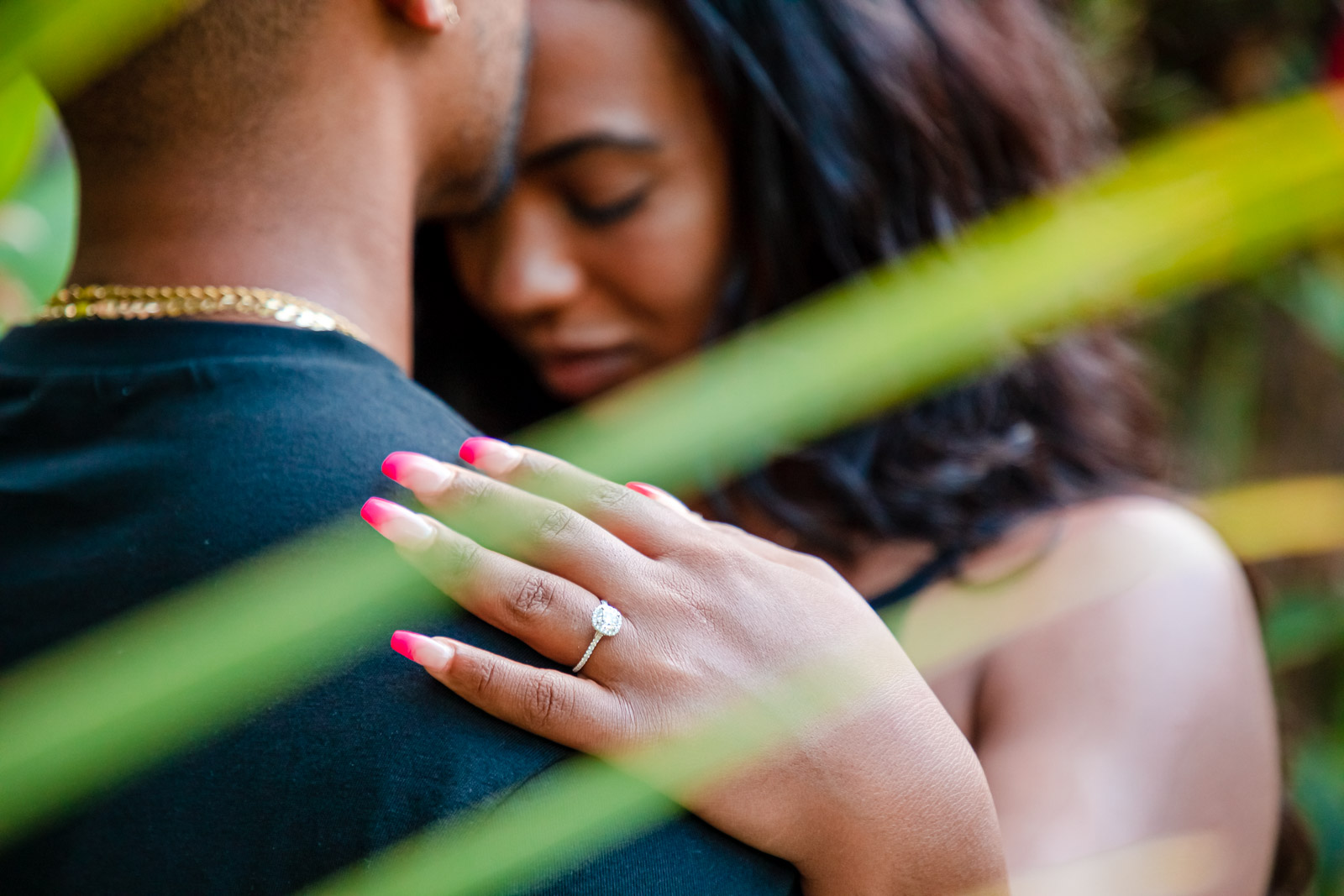 surprise proposal ring finger she said yes couples portrait oahu waikiki hawaii
