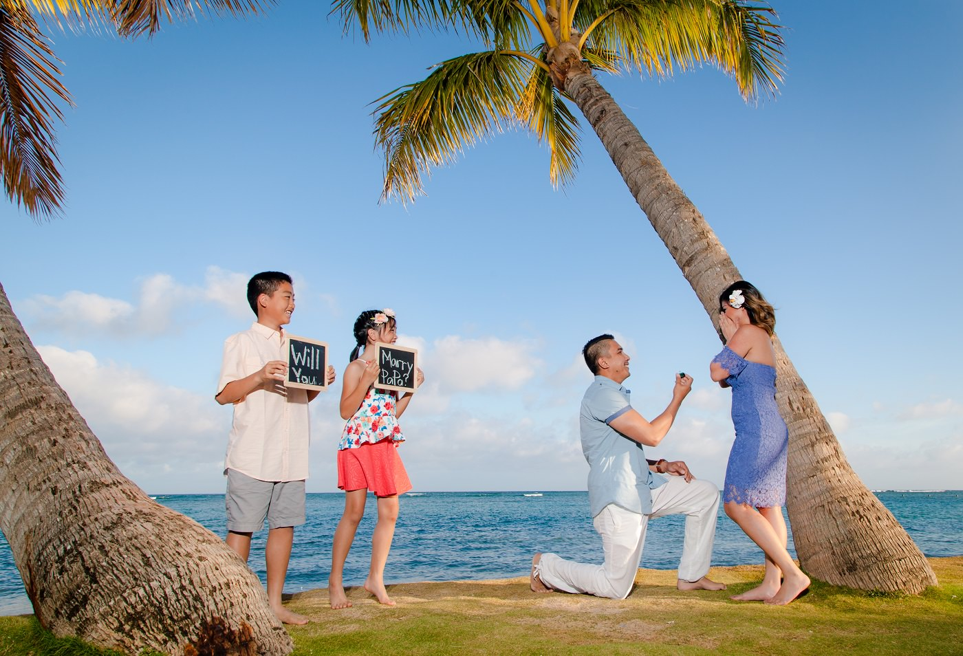 surprise proposal with kids helping dad with mom oahu hawaii photography