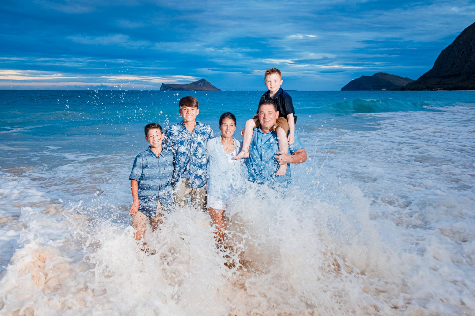 fun family oahu vacation photography ocean wave sunset splash