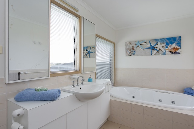Upstairs bathroom with 2 seater bath with views, shower and toilet