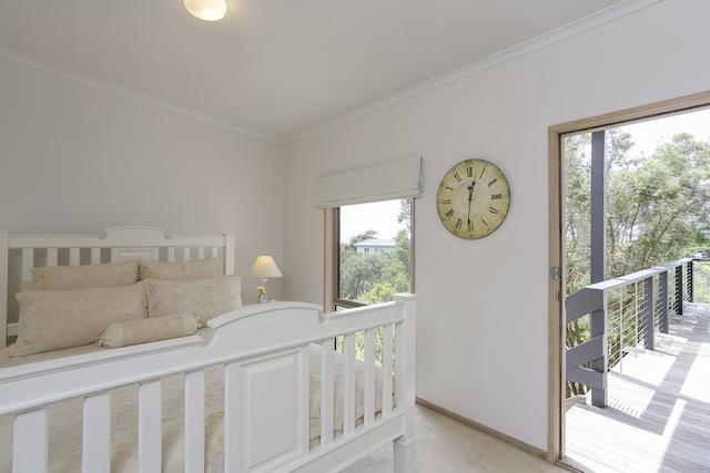 Bedroom 3 with door leading to deck