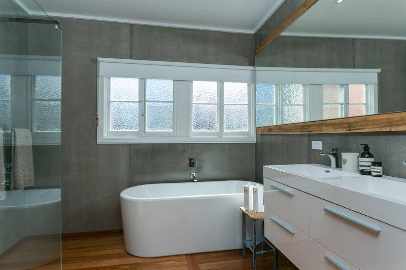 Main bathroom (downstairs) with shower, double vanity and freestanding bath