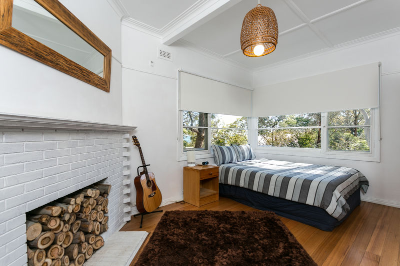 Bedroom 2, double with dual aspect windows with bay views. DIrect access to upstairs bathroom.