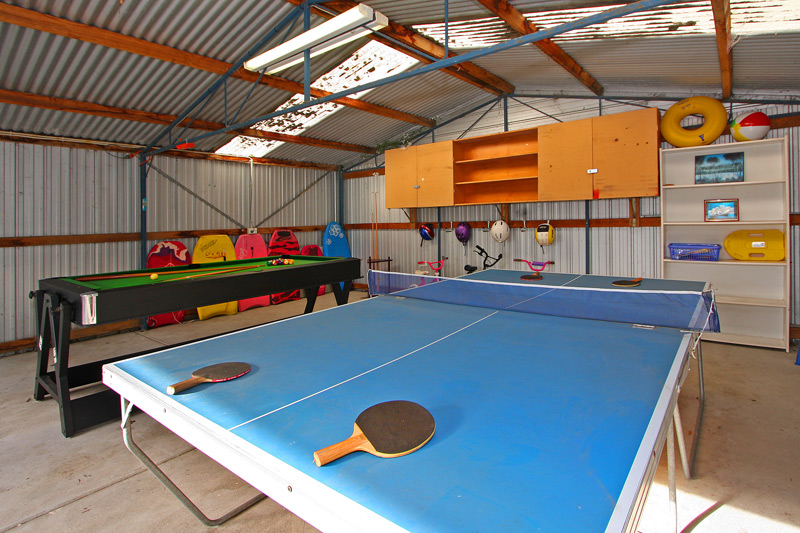 Games room with table tennis, pool table, air hockey plus more!
