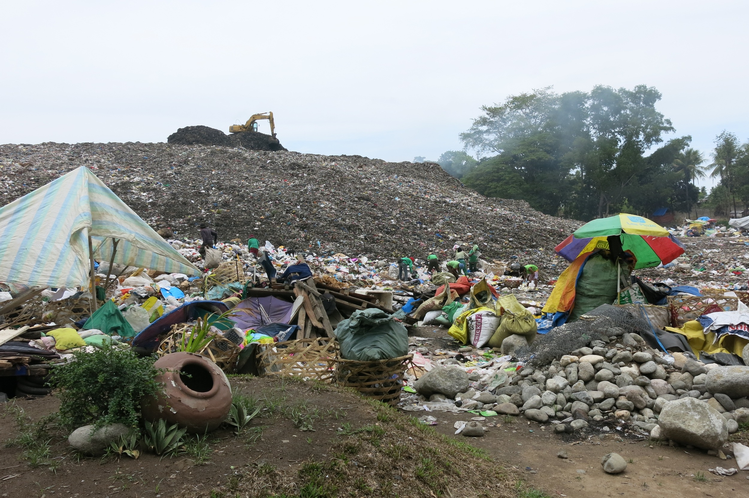 Members of the BaCaSA (Balugo Candau-ay Scavengers Association) search for recyclables