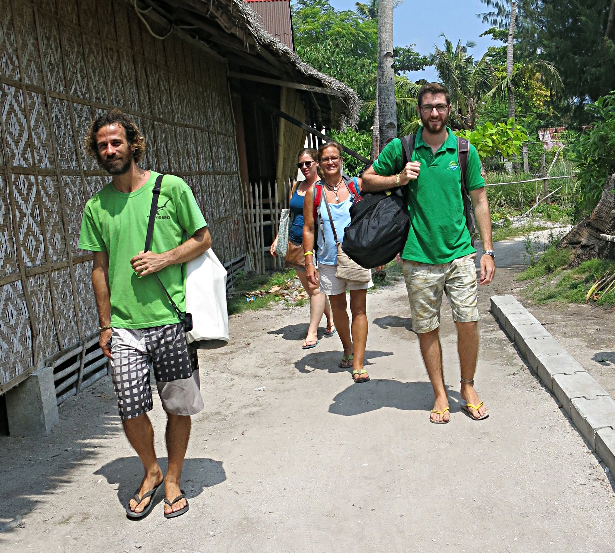 Walking the beat and carrying my dive kit back from assessment on on of the less sandy roads of Malapascua