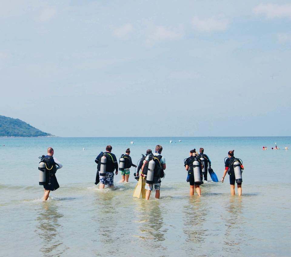 blueotwo divers head out on an underwater reef cleanup