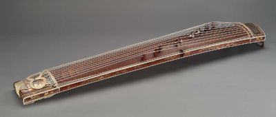 19th century Japanese koto from MFA, Boston (mirrored for comparison, hence incorrect bridge arrangement) See original  here .