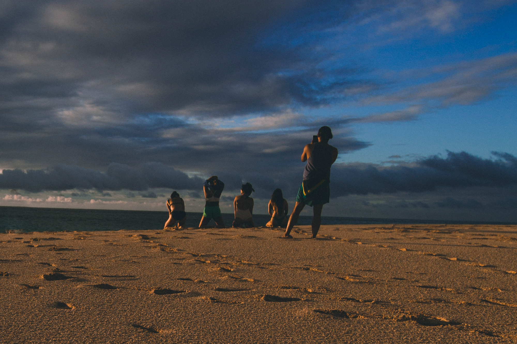 A legitimate photo I took on the beach in Hawaii last night. Four girls posing on the beach while their friend takes photos for Instagram.