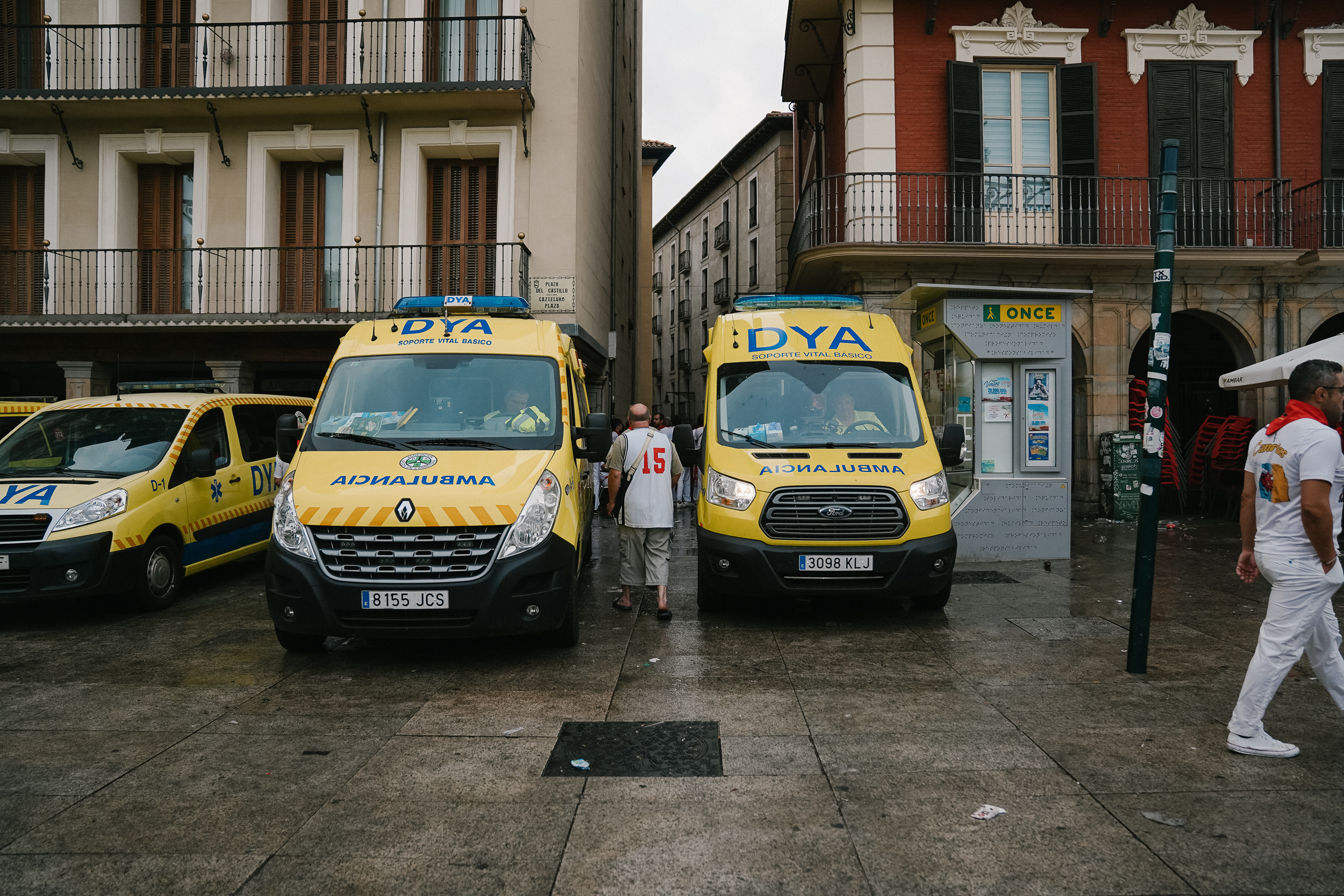 Ambulances wait behind the narrow city streets for injuries or deaths.