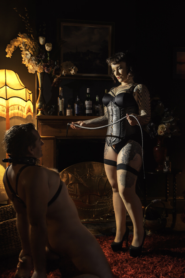 Miss Tallula single tail whip leather corset dominant.jpg
