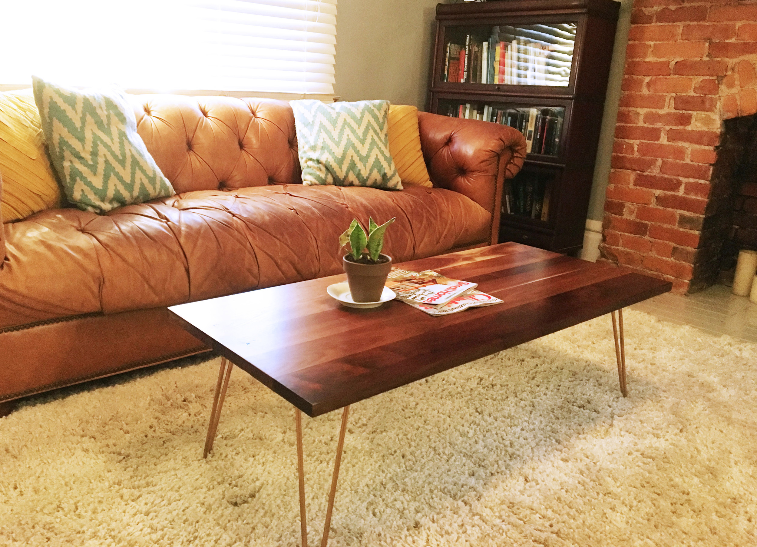 Black walnut table with gold hairpin legs